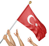 Team of peoples hands raising the Turkey national flag. 3D rendering isolated on white background Stock Photos