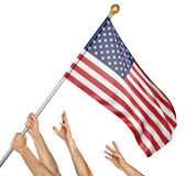 Team of peoples hands raising the United States national flag. 3D rendering isolated on white background Stock Images