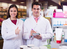 Team of pharmaceutist and technician working in chemist shop Stock Image