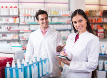 Team of pharmaceutist and technician working in chemist shop Stock Photography