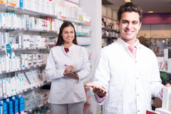 Team of pharmaceutist and technician working in chemist shop Royalty Free Stock Photos