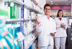 Team of pharmaceutist and technician working in chemist shop Stock Images