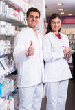 Team of pharmaceutist and technician working in chemist shop Royalty Free Stock Photo