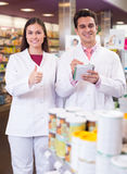 Team of pharmaceutist and technician working in chemist shop Royalty Free Stock Images