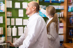 Team of pharmaceutist  working in shop Stock Photos