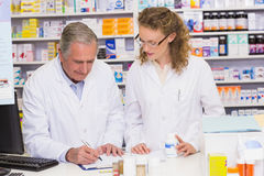 Team of pharmacist looking a medication for a prescription stock photos