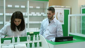 Team of pharmacists having conflict at the hospital pharmacy stock video