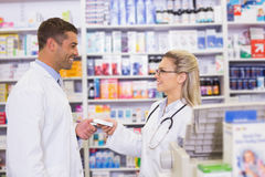 Team of pharmacists holding medecines Royalty Free Stock Image