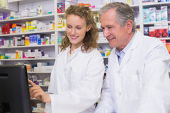Team of pharmacists looking at computer Stock Photography