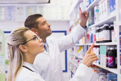 Team of pharmacists looking at medicine Royalty Free Stock Images