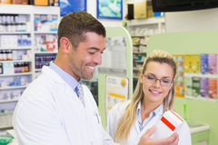 Team of pharmacists looking at medicine Stock Photos