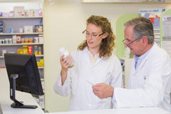 Team of pharmacists looking at medicine Royalty Free Stock Photo