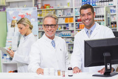 Team of pharmacists smiling at camera Royalty Free Stock Image