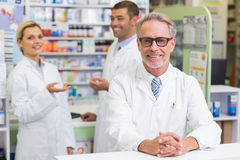 Team of pharmacists smiling at camera Royalty Free Stock Photo