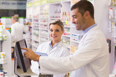 Team of pharmacists using computer Stock Photos
