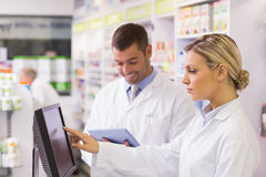 Team of pharmacists using computer Royalty Free Stock Photos