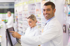 Team of pharmacists using computer Royalty Free Stock Photography