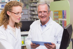 Team of pharmacists using laptop pc and computer Royalty Free Stock Photography