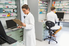 Team of pharmacists working on computers Stock Photography