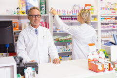 Team of pharmacists working together Stock Images