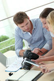Team of photo journalists working at office. Team of photo reporters working in office Royalty Free Stock Photography