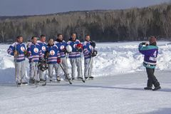 Team photo at the New England Pond Hockey Festival, Rangeley, Ma. Rangeley, Maine/USA - February 4, 2017: Time for an Old Salts team photo at the 11th annual New Royalty Free Stock Images