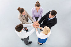 Team placing hands over each others. High angle view royalty free stock photos