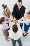 Team placing hands over each others. High angle view stock photos