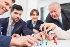 Team play board game. Business team play board game in team building workshop stock image