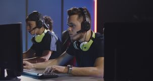 Team playing at a tournament. Medium shot of a team playing at a gaming tournament stock video footage