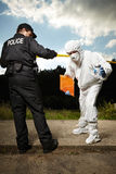 Team of police man and technician behind barrier tape Stock Photos