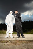 Team of police man and technician Stock Images