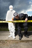 Team of police man and technician Stock Photography