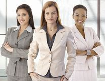 Team portrait of happy businesswomen in office Royalty Free Stock Photos
