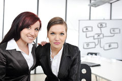 Portrait of two businesswomen in business presentation Royalty Free Stock Photography