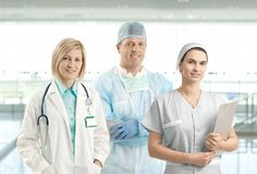 Team portrait of smiling healthcare professionals Stock Photos