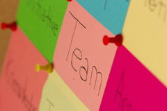 Team post-it on coarkboard background Royalty Free Stock Image