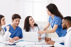Team Of Practitioners Examining Medical Reports On Laptop stock photos