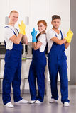 Team of professional cleaners. Team of content professional cleaners wearing uniforms and rubber gloves stock images