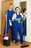 Team of professional cleaners. Doing chores in your company royalty free stock photo