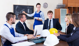 Team of professional engineers having meeting Royalty Free Stock Photo