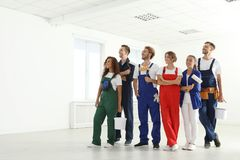 Team of professional painters with tools working. Indoors royalty free stock photo