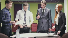 Team of professionals discusses the project, brainstorming in a business meeting. Static shot stock footage