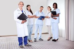 Team of professionals lead by mature doctor Royalty Free Stock Photography