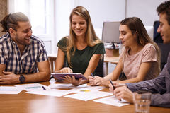 Team of professionals in a meeting Stock Photos