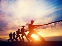 Free Team Pulling Line Together. Tug Of War Stock Image - 158886161
