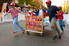 Team Pushes Bed Through Turn In Odd Mattress Race Royalty Free Stock Photos
