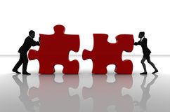 Team pushing jigsaw puzzle pieces Royalty Free Stock Images