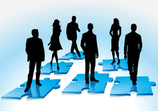 Team puzzle. Silhouettes people specification Stock Photography