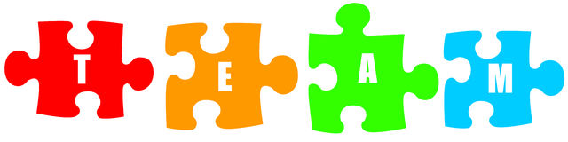 Team puzzle. Teamwork putting the puzzle pieces together Royalty Free Stock Photography